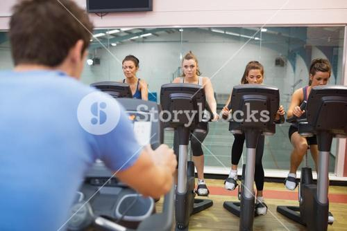Man instructs spinning class