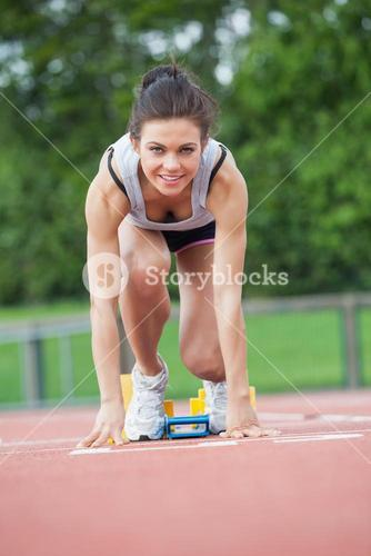 Female athlete at starting blocks