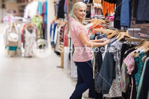 Woman is searching clothes smiling