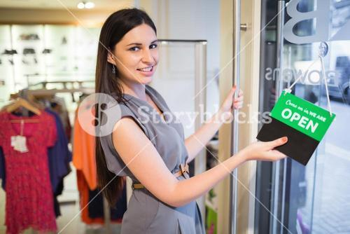 Woman opening clothes store