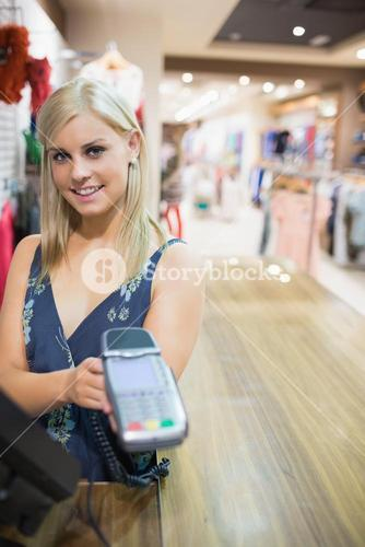 Woman showing credit card machine