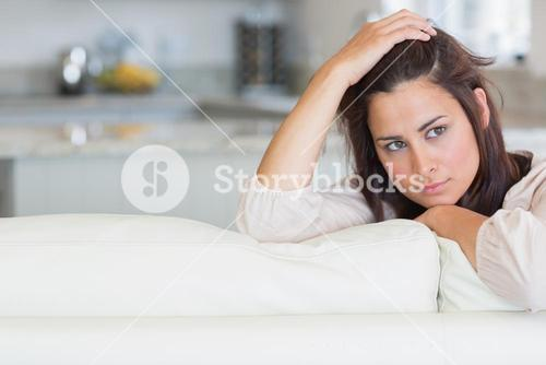 Woman holding hand on head