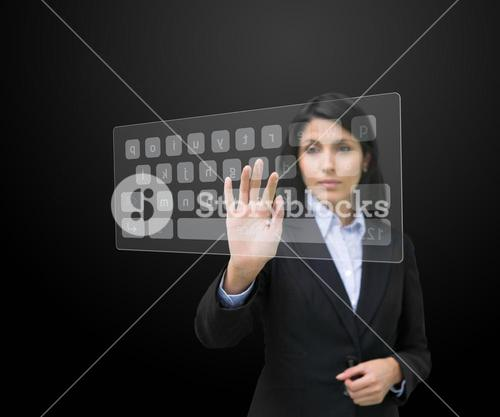Woman typing on digital keyboard