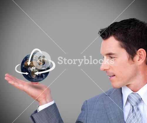 Hovering globe in Businessmans hand