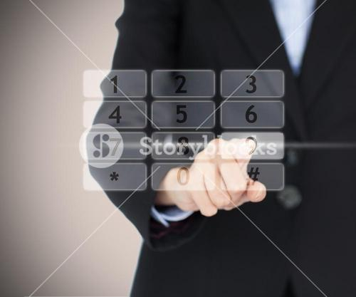 Business woman entering code on digital number pad