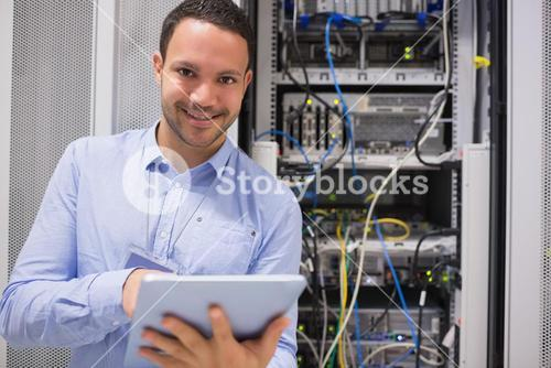 Happy worker with tablet pc