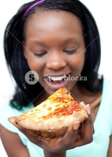 Happy woman eating a pizza