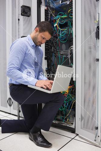 Concentrated technician doing data storage