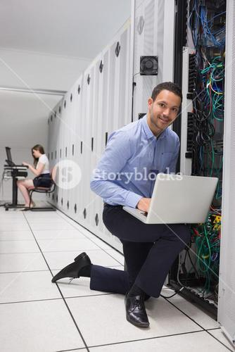 Two people doing data storage