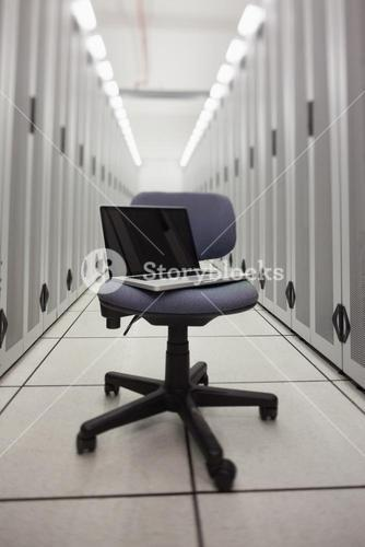 Laptop on a chair in hallway