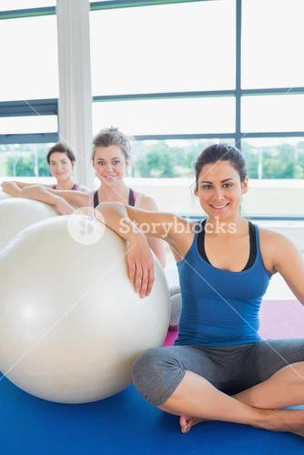 Women sitting with exercise balls