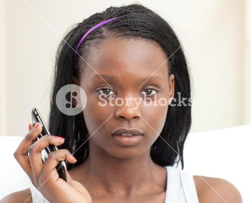 Beautiful woman on phone in the livingroom