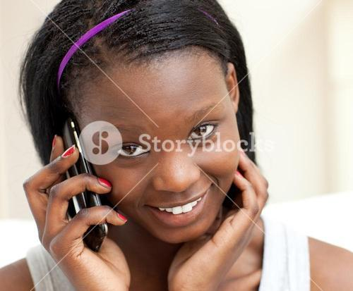 Smiling woman on phone in the livingroom