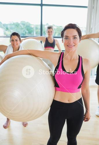 Happy group with exercise balls