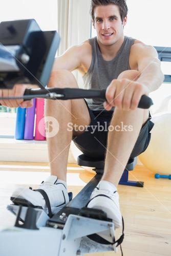 Man working out on row machine