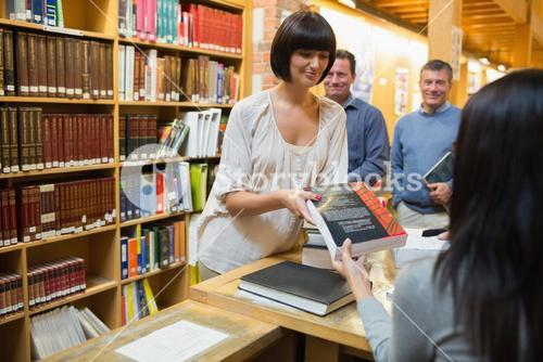 Woman taking out book