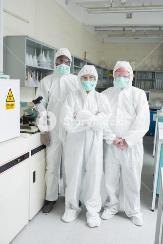 Team of chemists in protective suits