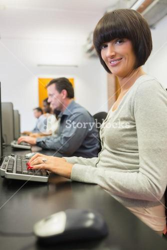 Happy woman in computer class