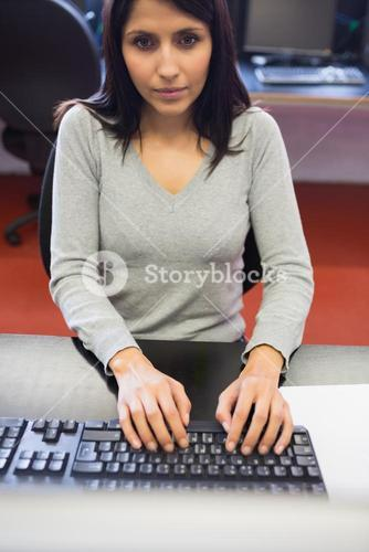 Woman typing in computer class