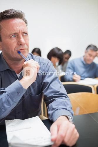 Mature student thinking in class