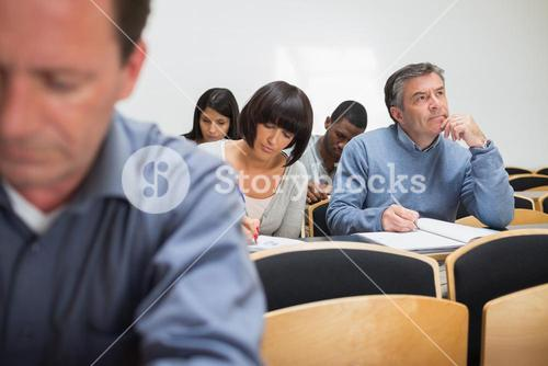 Adult class taking notes