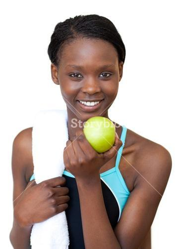 Fitness woman eating an apple