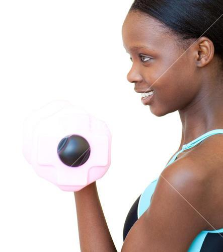 Positive woman working out with dumbbell