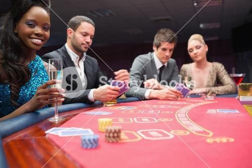 People sitting around the poker table