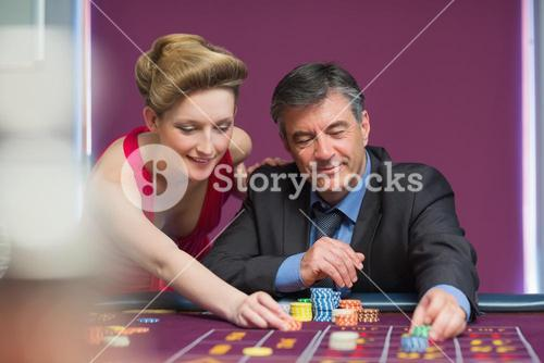 Man and woman placing bets