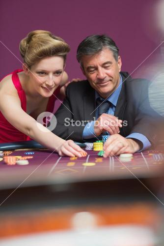 Woman and man placing bets