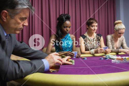 Man with whiskey placing bet