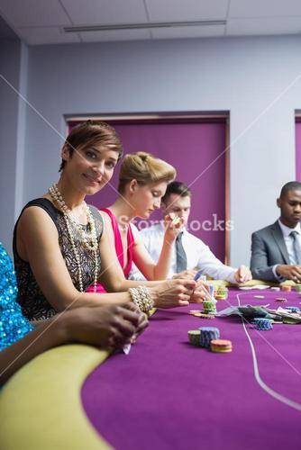 Woman smiling sitting at the poker table