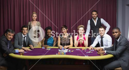Welldressed group at poker table
