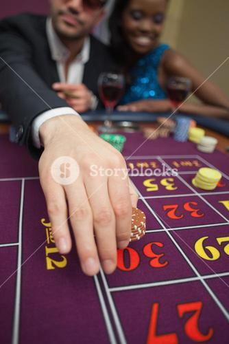 Man placing bet on roulette