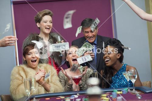 People throwing money at the casino
