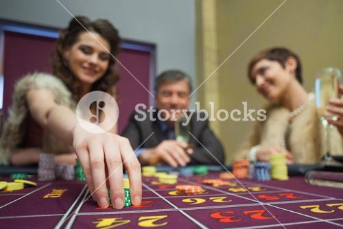 Woman placing a bet in roulette