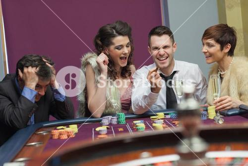 Winner and loser at roulette table