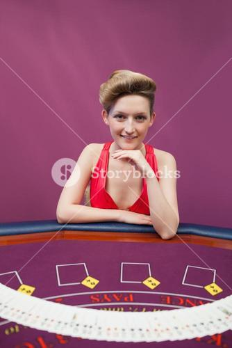 Woman at poker table with spread deck