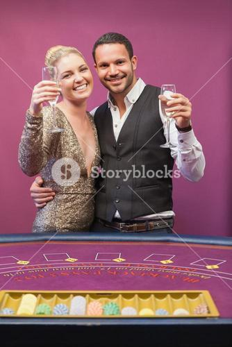 Two people toasting in a casino