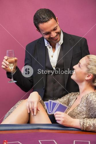 Two people flirting at poker table