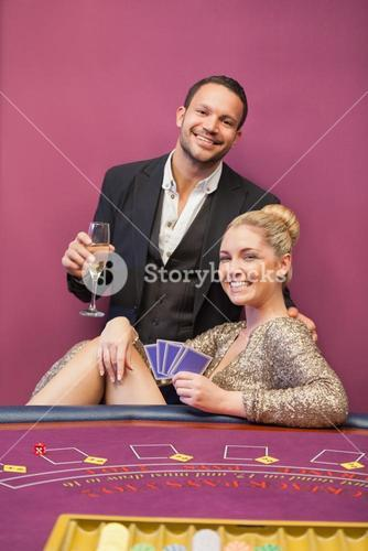 Happy couple at poker table