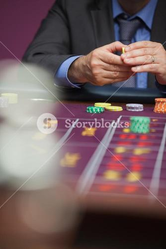 Man placing bet at roulette