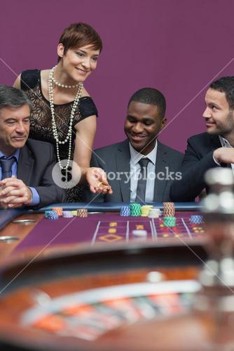 Woman placing bet at roulette table