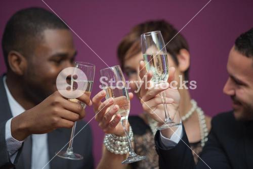 Three people toasting and celebrating in a casino