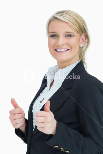 Woman smiling and showing thumbs up