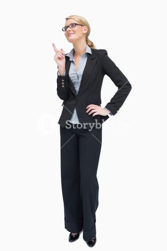 Smiling businesswoman thinking