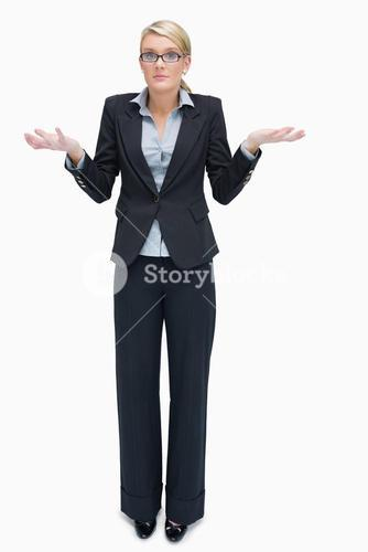 Business woman giving I dont know gesture