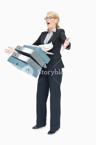 Businesswoman dropping many folders
