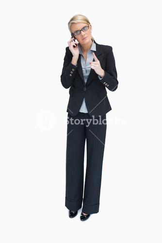 Businesswoman giving out on phone