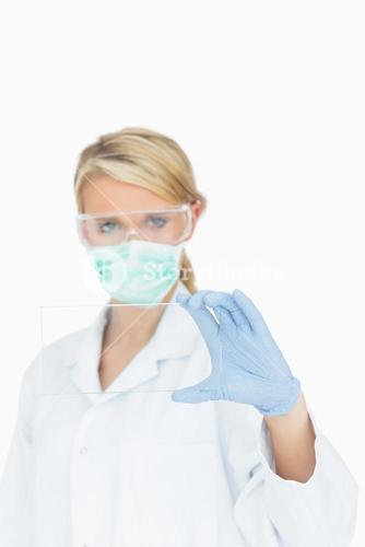 Surgeon studying clear pane